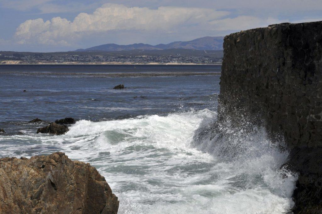 Waves crashing against a rocky wall